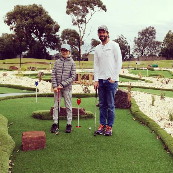 Dad and son at Sandy Mini Golf